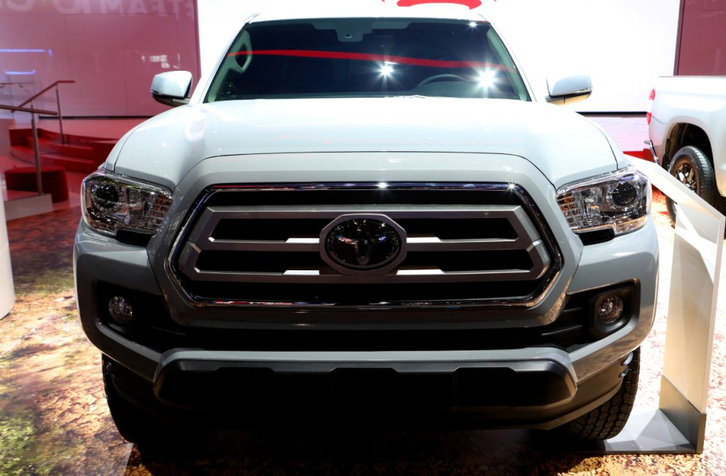 The front grille of a Toyota Tacoma on display at an auto show