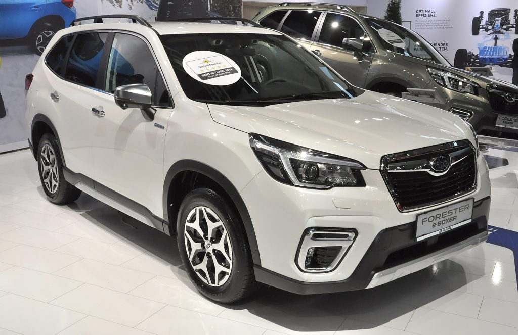 A white Subaru Forester on display at an auto show
