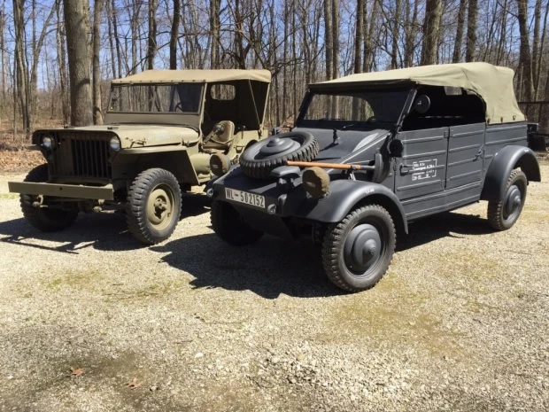 A tan Willys Jeep next to a gray 1942 Volkswagen Type 82 Kubelwagen