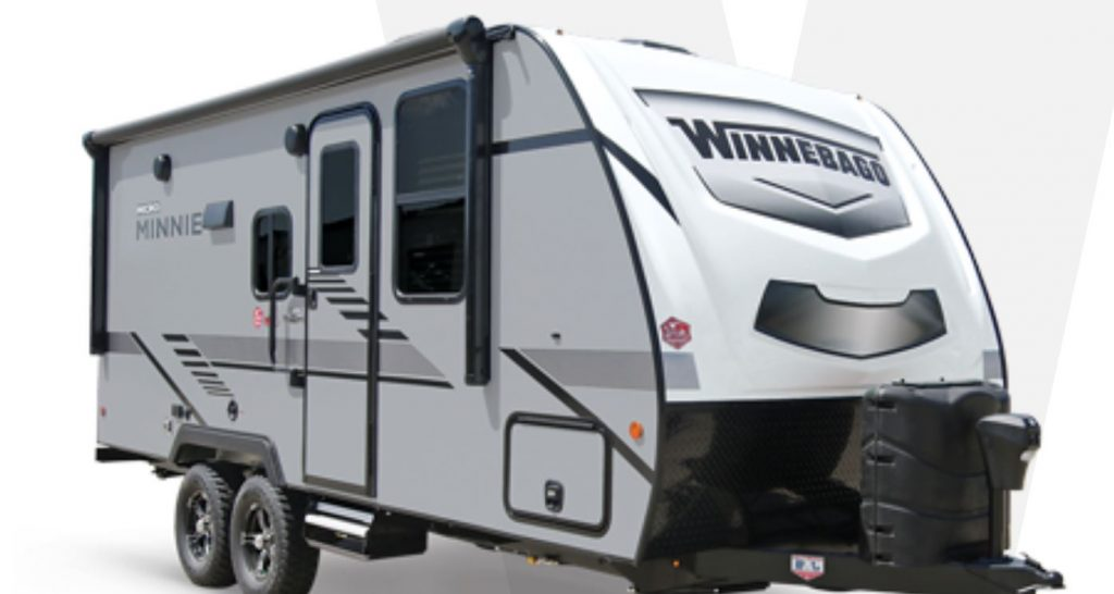 A white travel trailer by Winnebago called the Micro Minni