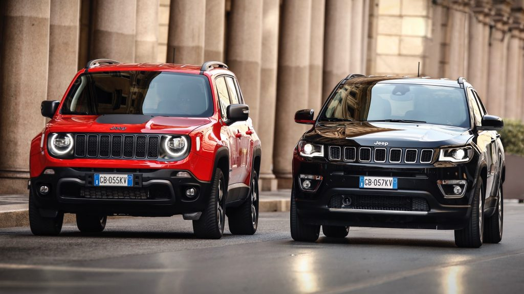 Jeep Renegade 4xe and Jeep Compass 4xe parked on street