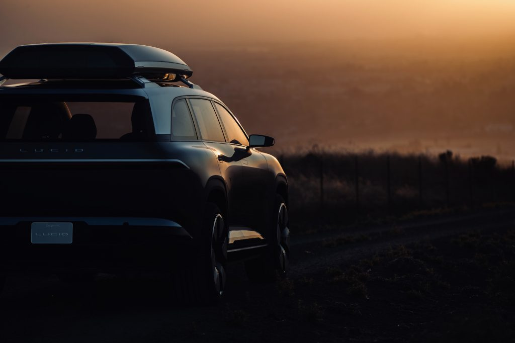 The Lucid SUV, revealed to be called the Lucid Gravity, parked while basking in the sunset