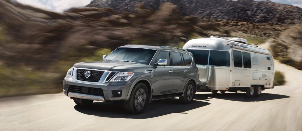 A 2020 gray Nissan Armada towing a travel trailer RV.