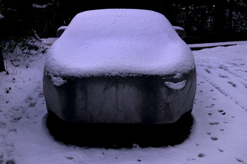 covered snowy porsche