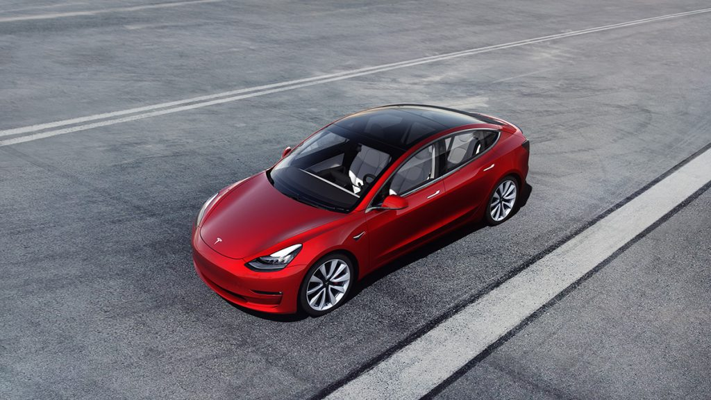 the electric Tesla Model 3 driving on the highway