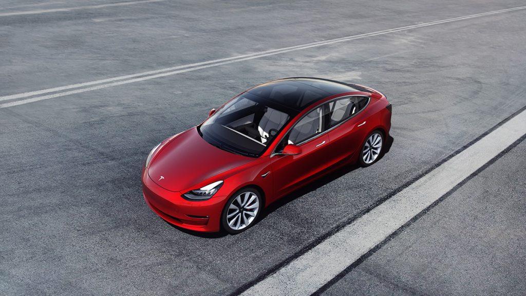 Tesla Model 3 driving on the highway