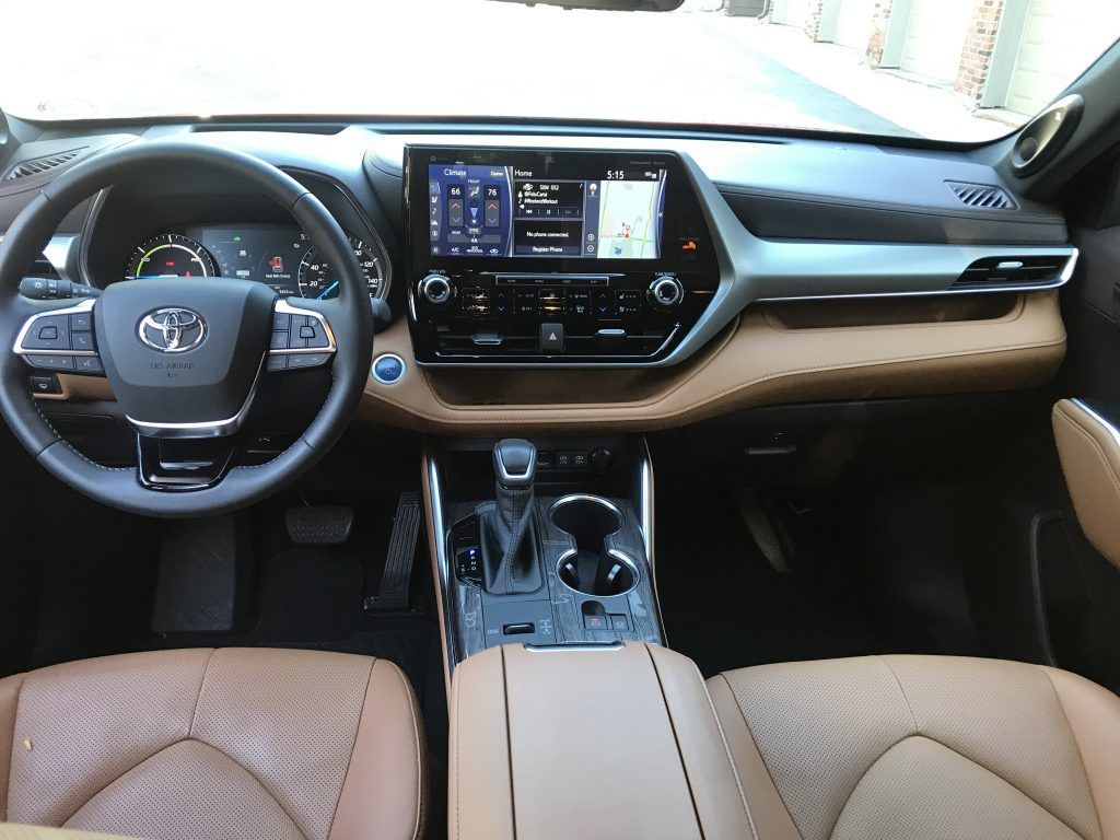 A 2020 Toyota Highlander Hybrid with brown leather seats.