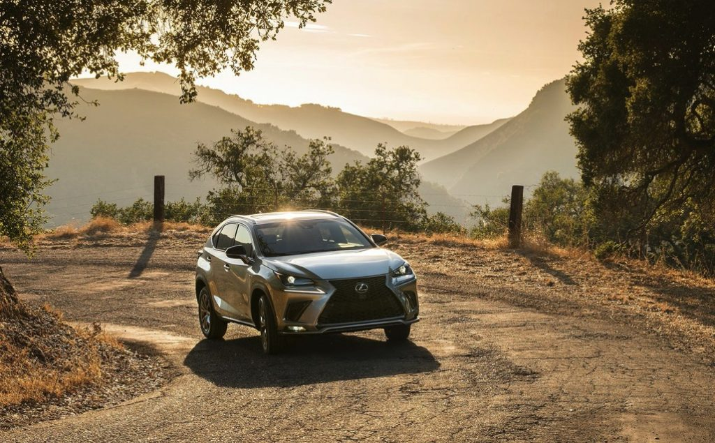 the lexus NX driving in the country