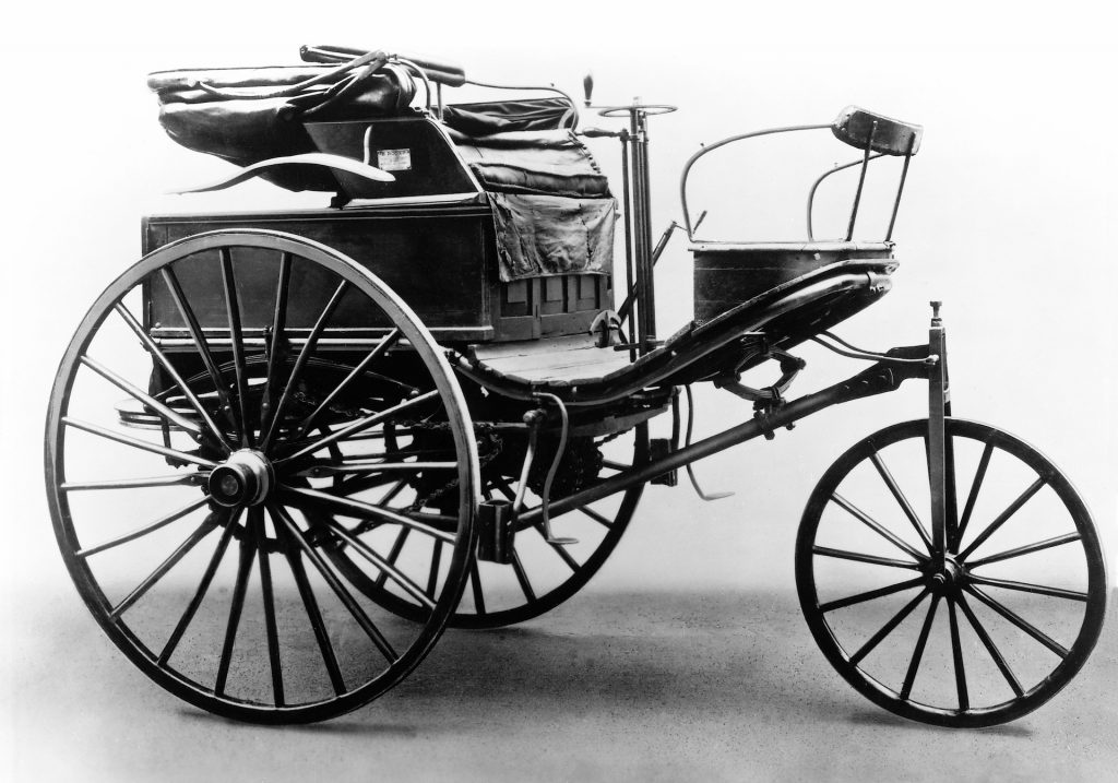 A photo of a vintage Benz & Co. ad depicting the Patent-Motorwagen.