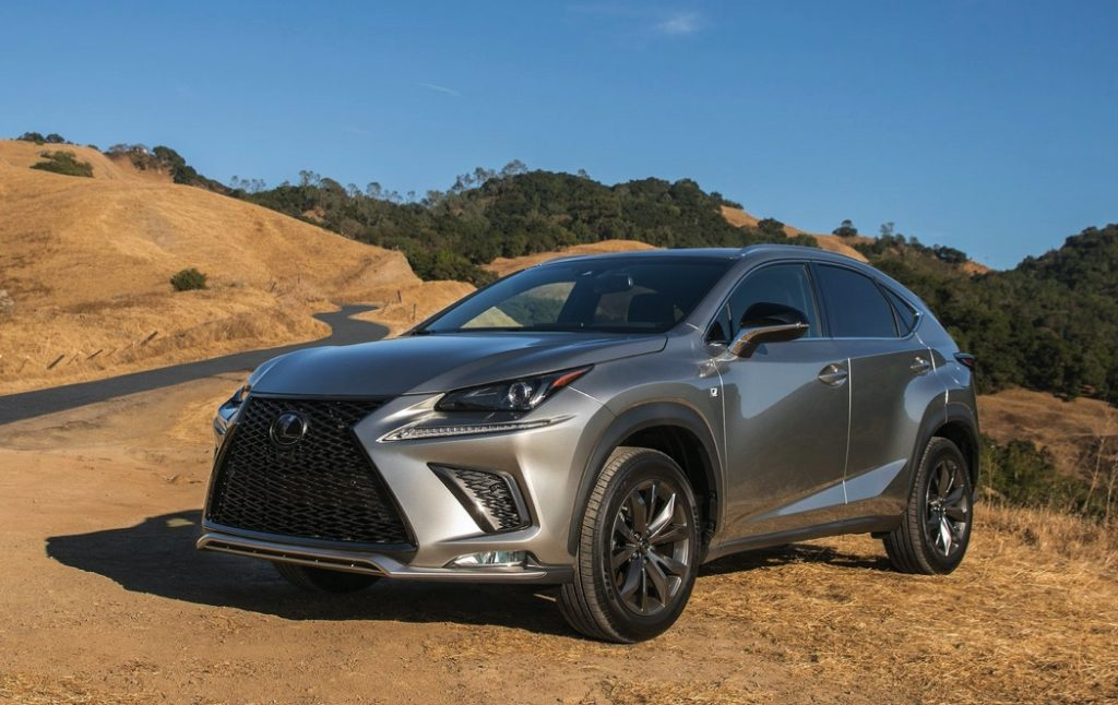silver Lexus NX compact luxury SUV on sand