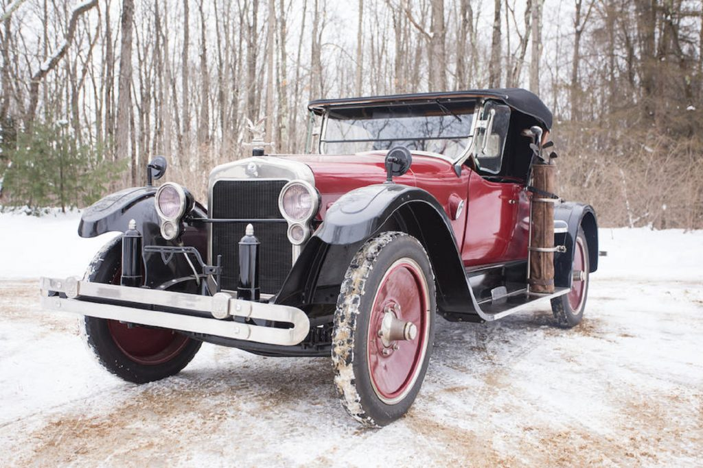 A red-and-black 1922 Wills Sainte Claire Model A-68 Rumble-Seat Roadster in the snow