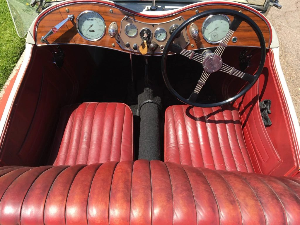 The red-leather interior of a 1949 MG TC EXU