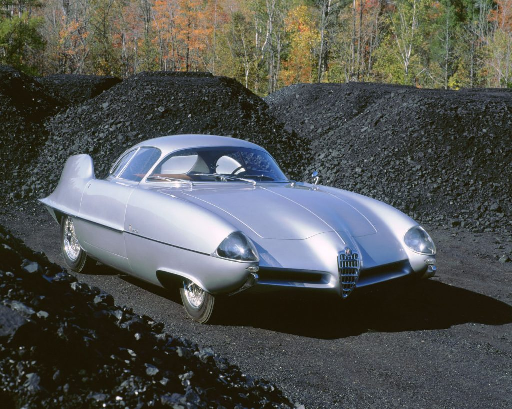 The silver 1955 Alfa Romeo BAT 9 parked amongst coal