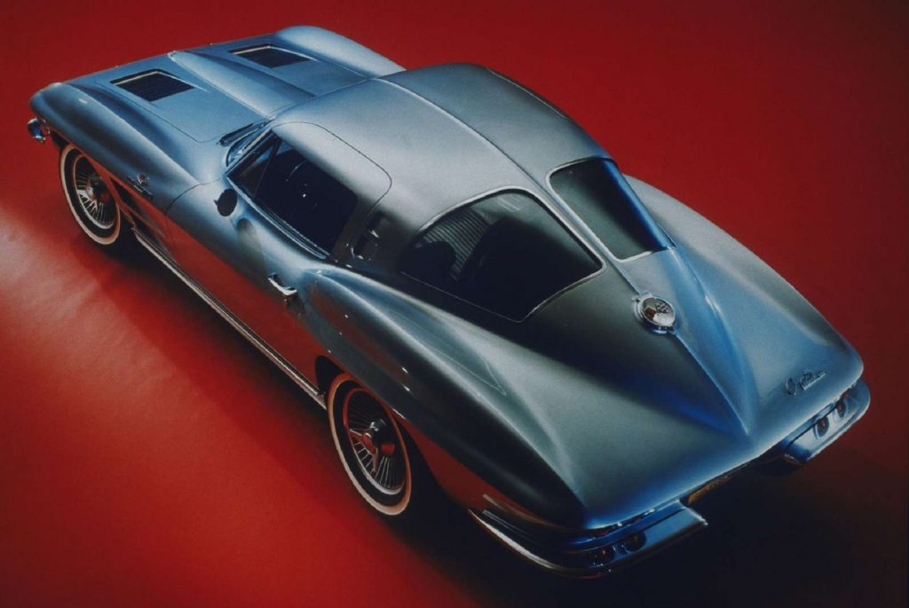 The overhead 3/4 view of a blue 1963 Chevrolet Corvette Sting Ray coupe