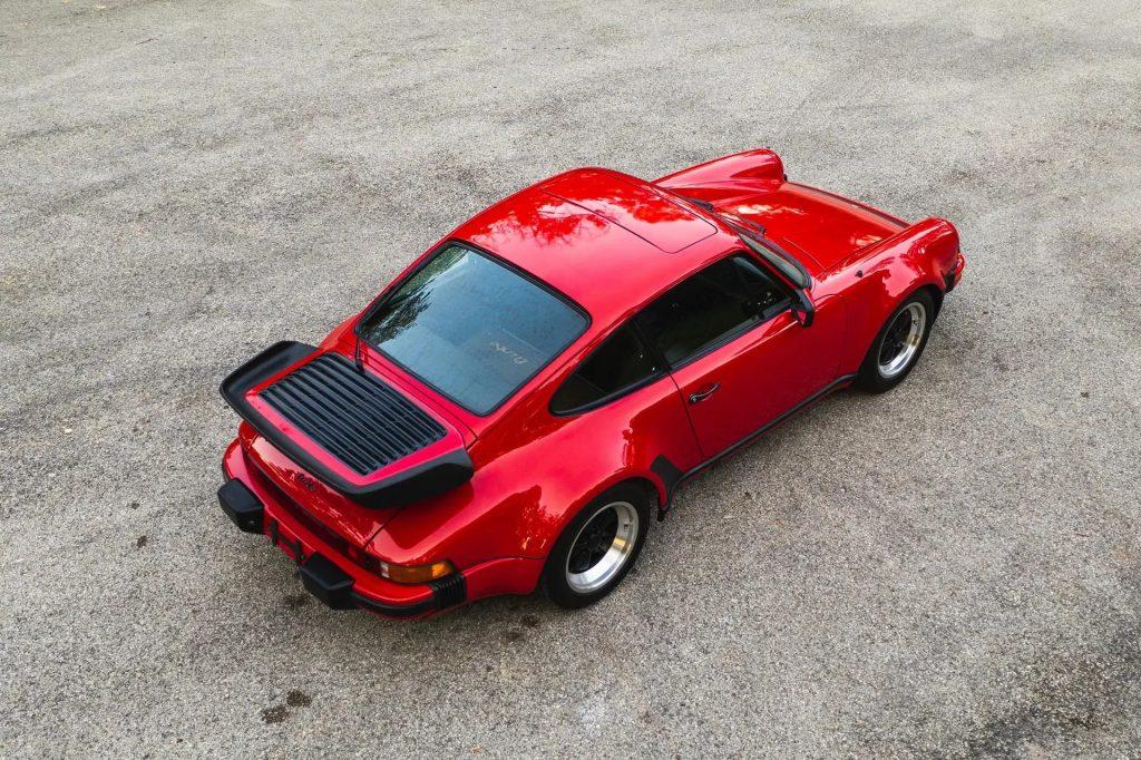 An overhead rear 3/4 view of a red 1978 Porsche 930 911 Turbo