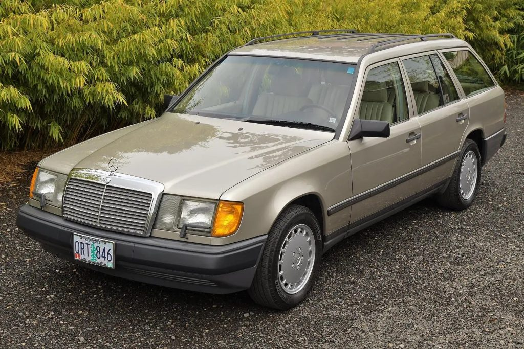 A tan 1987 W124 Mercedes-Benz 300TD wagon