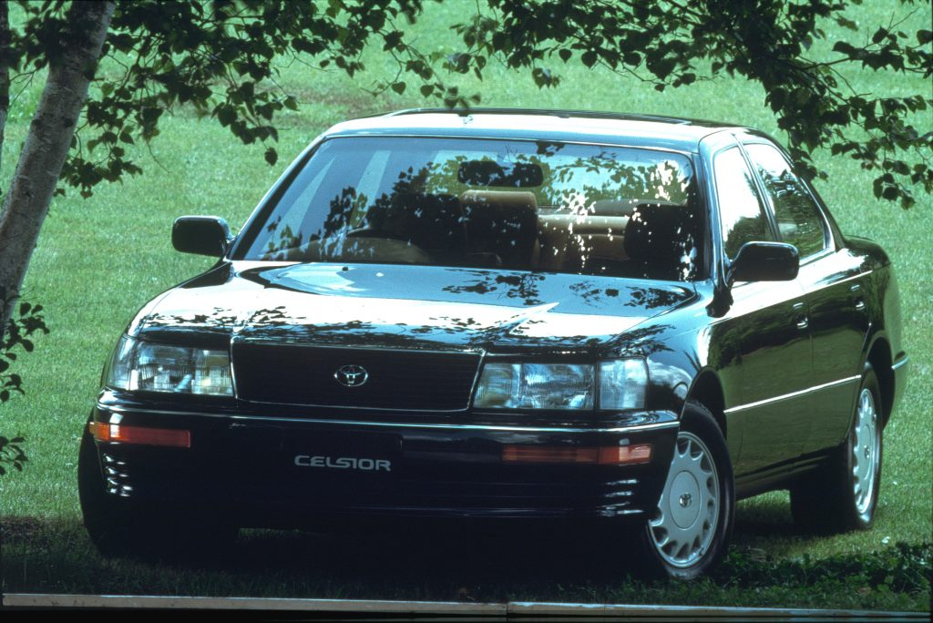 A black 1990 Toyota Celsior underneath shady trees
