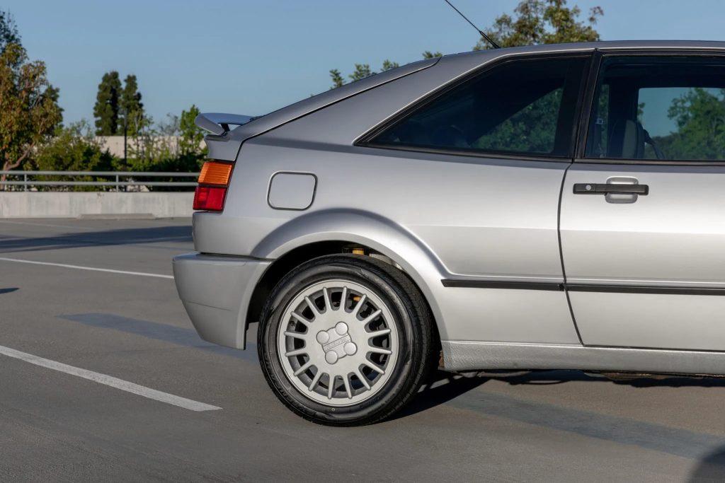 The rear half of a silver 1990 Volkswagen Corrado with its spoiler deployed