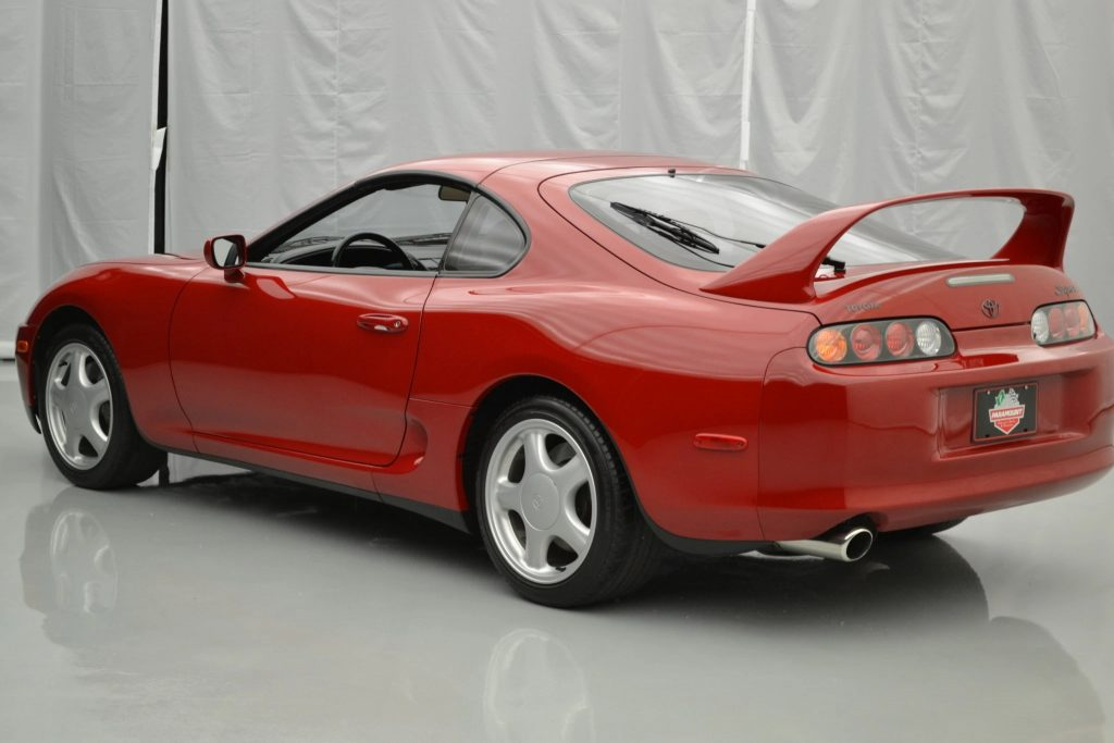 The rear view of a red 1994 Toyota Supra Turbo