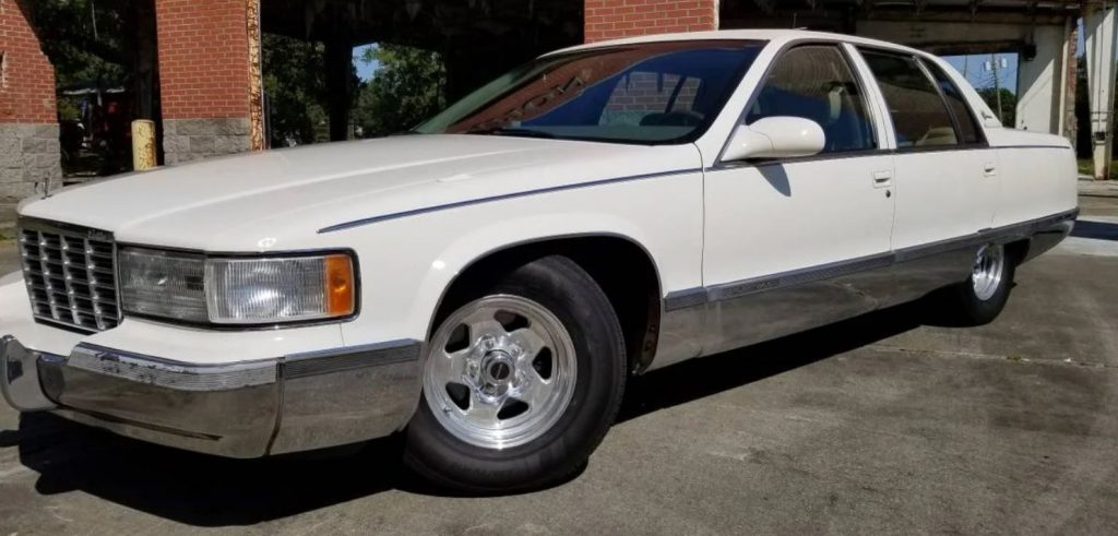 The front of a white custom 1996 Cadillac Fleetwood Brougham