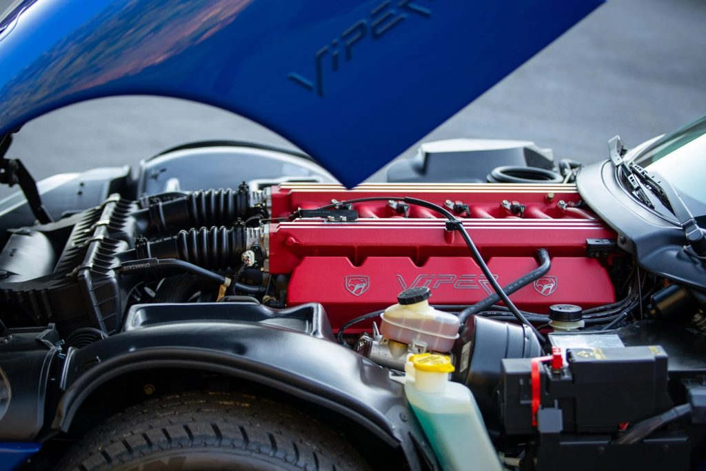 A close-up of the 1996 Dodge Viper GTS' V10 red-covered engine