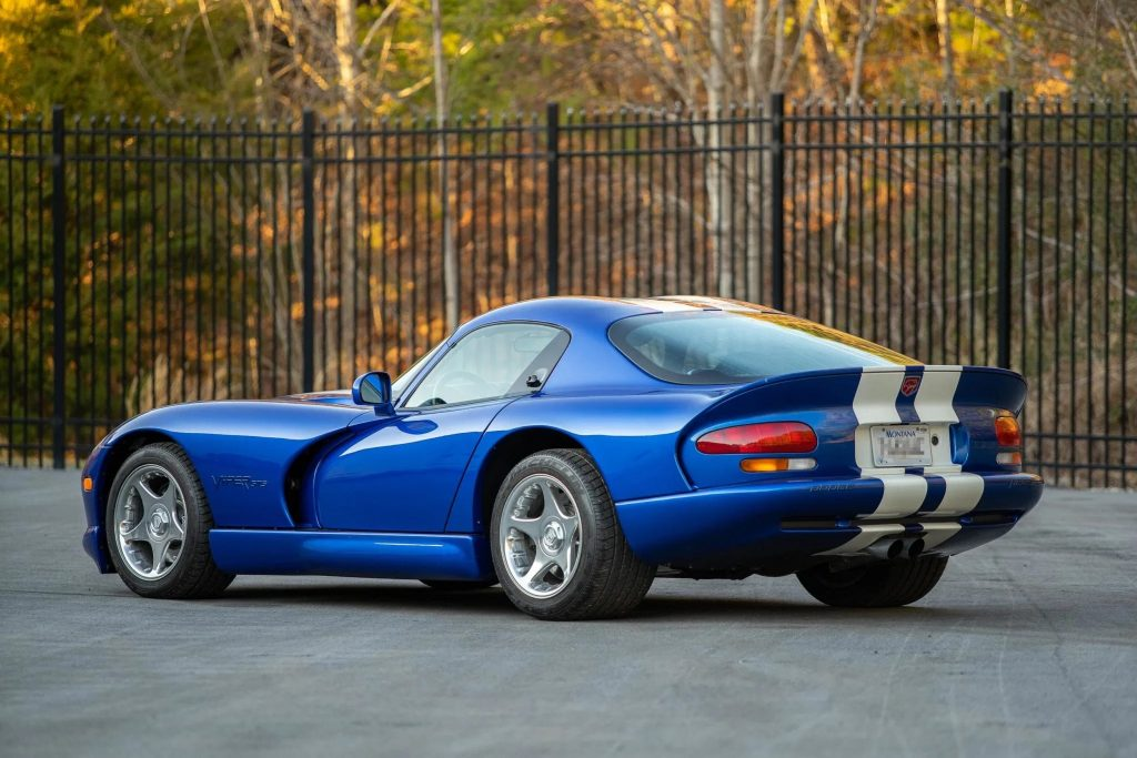 The rear 3/4 view of a blue-and-white 1996 Dodge Viper GTS coupe