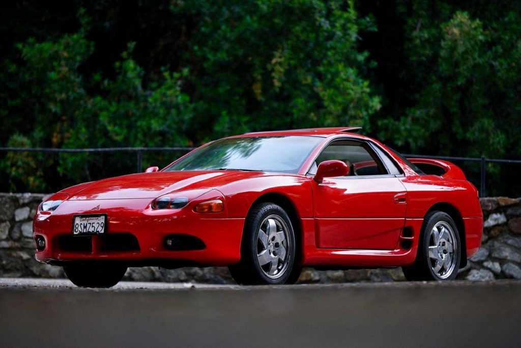 The front 3/4 view of a red 1997 Mitsubishi 3000GT SL