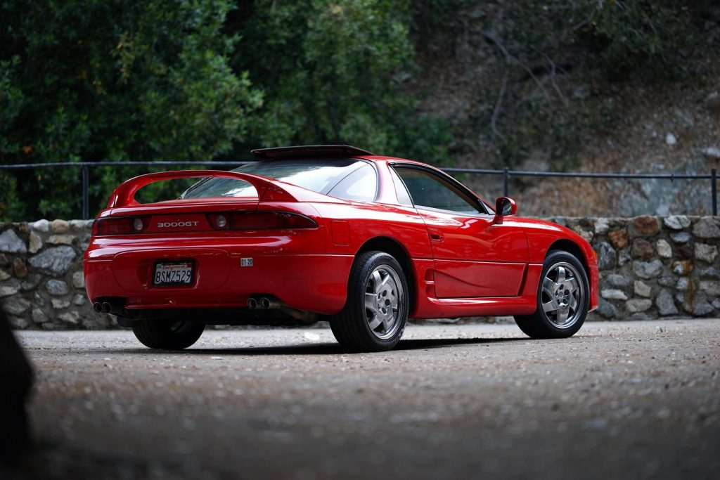 The rear 3/4 view of a red 1997 Mitsubishi 3000GT SL
