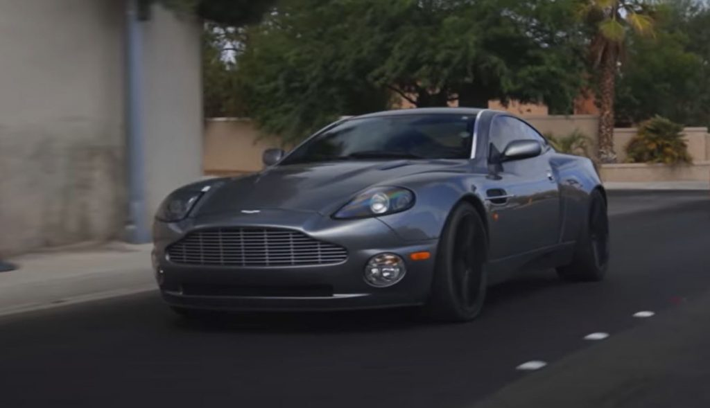 A gray 2003 Aston Martin Vanquish on the road