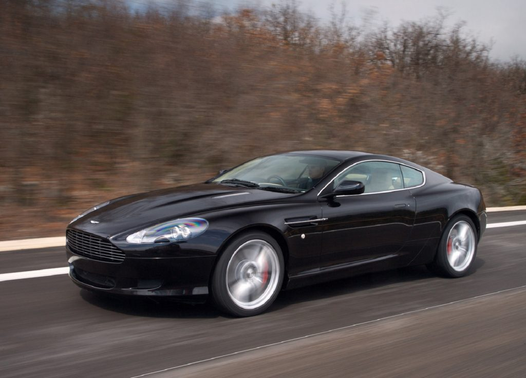 A black 2007 Aston Martin DB9 on a winter road