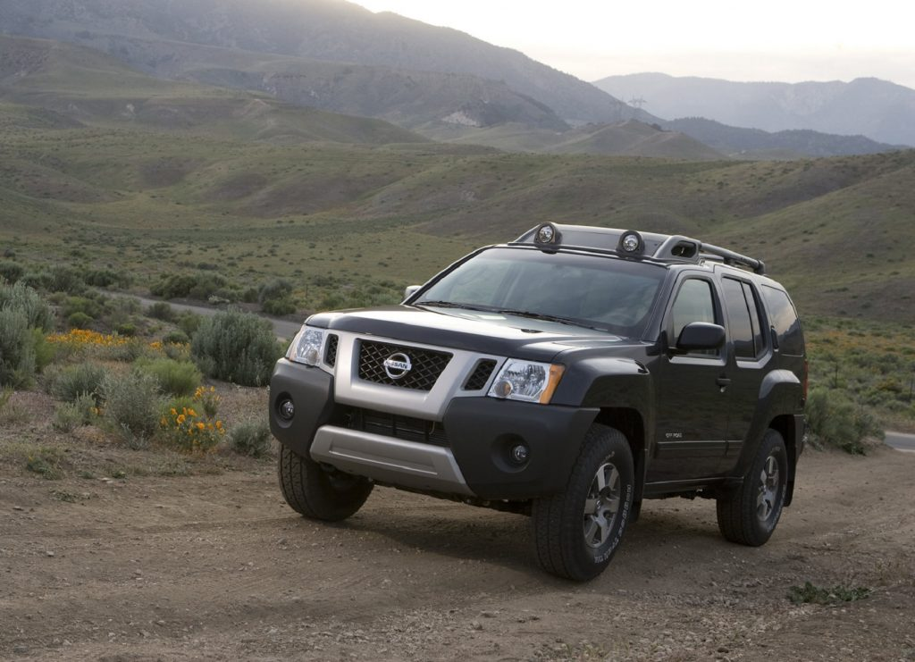 A black 2009 Nissan Xterra on an off-road trail