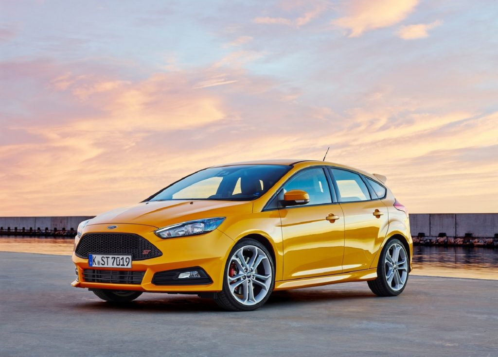 A yellow 2015 Ford Focus ST
