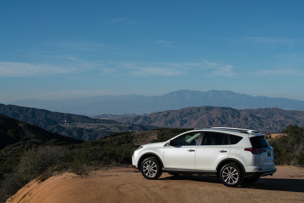 A white 2016 Toyota RAV4 off-road.