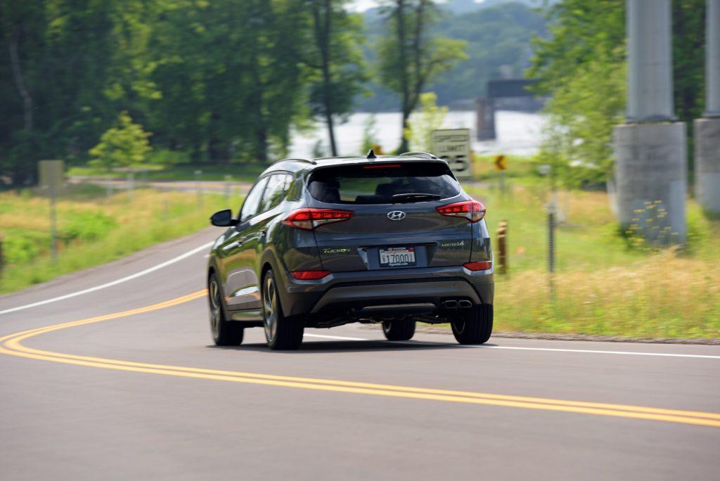 The 2017 Hyundai Tucson driving down a winding road.