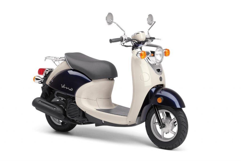 A tan-and-dark-blue 2017 Yamaha Vino 50 scooter