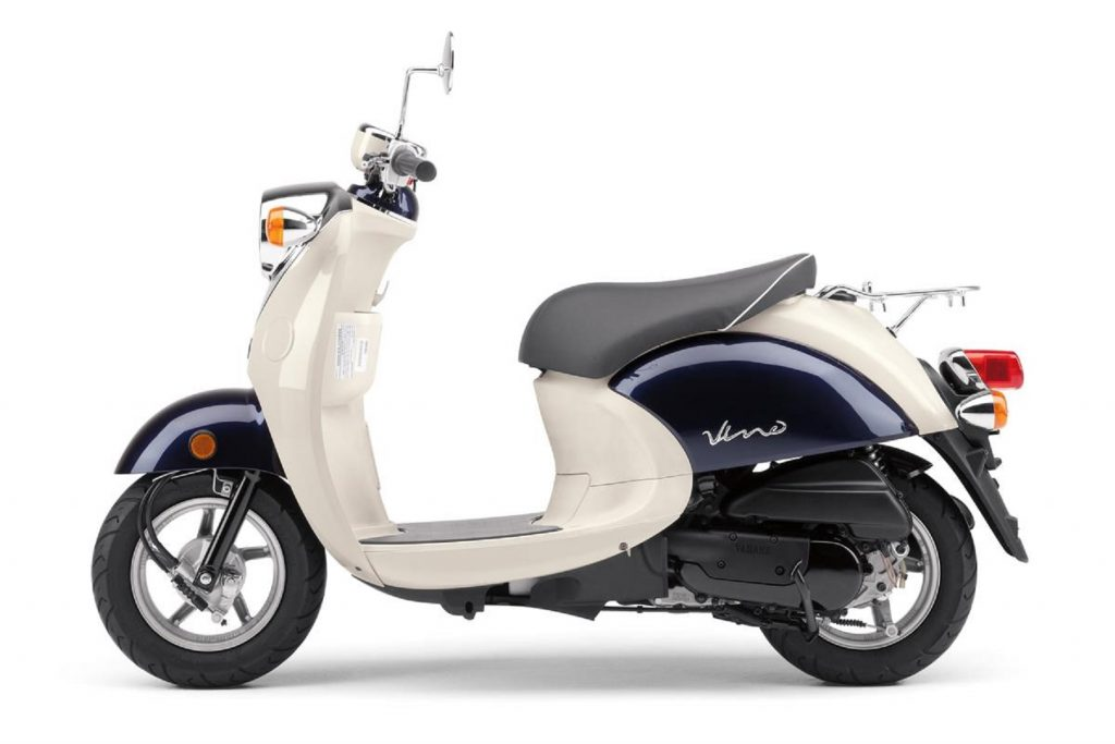 The side view of a tan-and-dark-blue 2017 Yamaha Vino 50 scooter