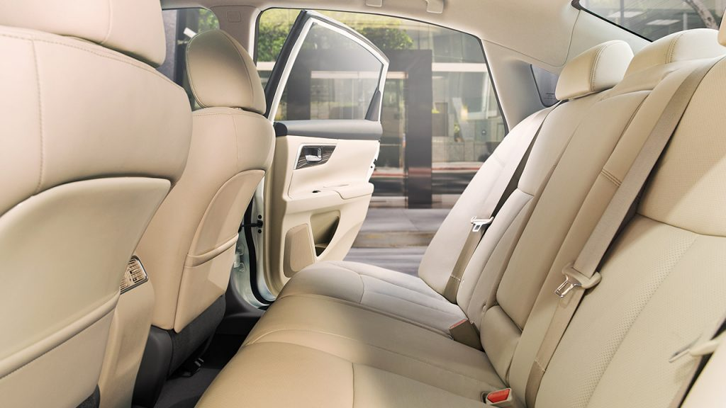The back row of a 2018 Nissan Altima with beige seats.