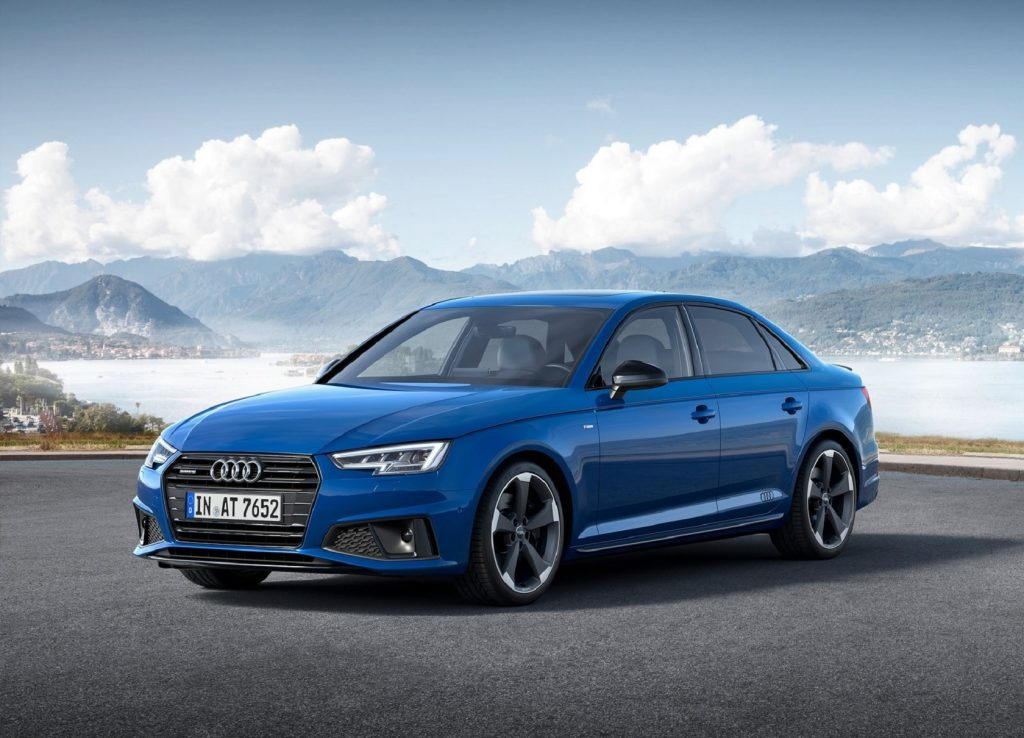 A blue 2019 Audi A4 in front of a lake