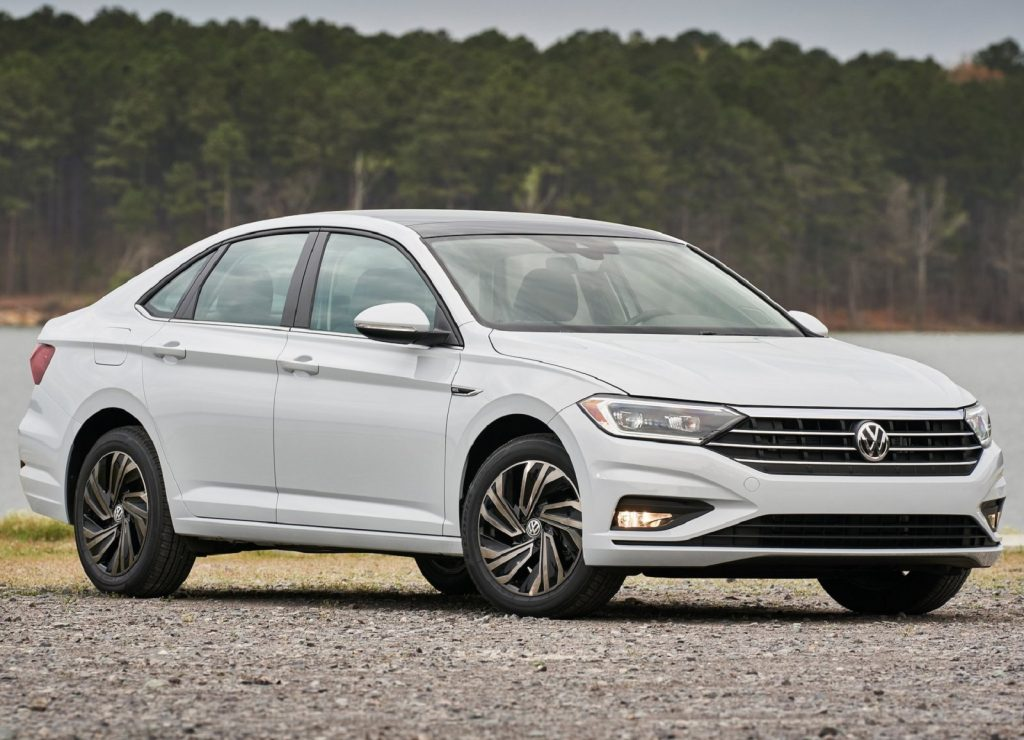 A white 2019 Volkswagen Jetta by a forest lake