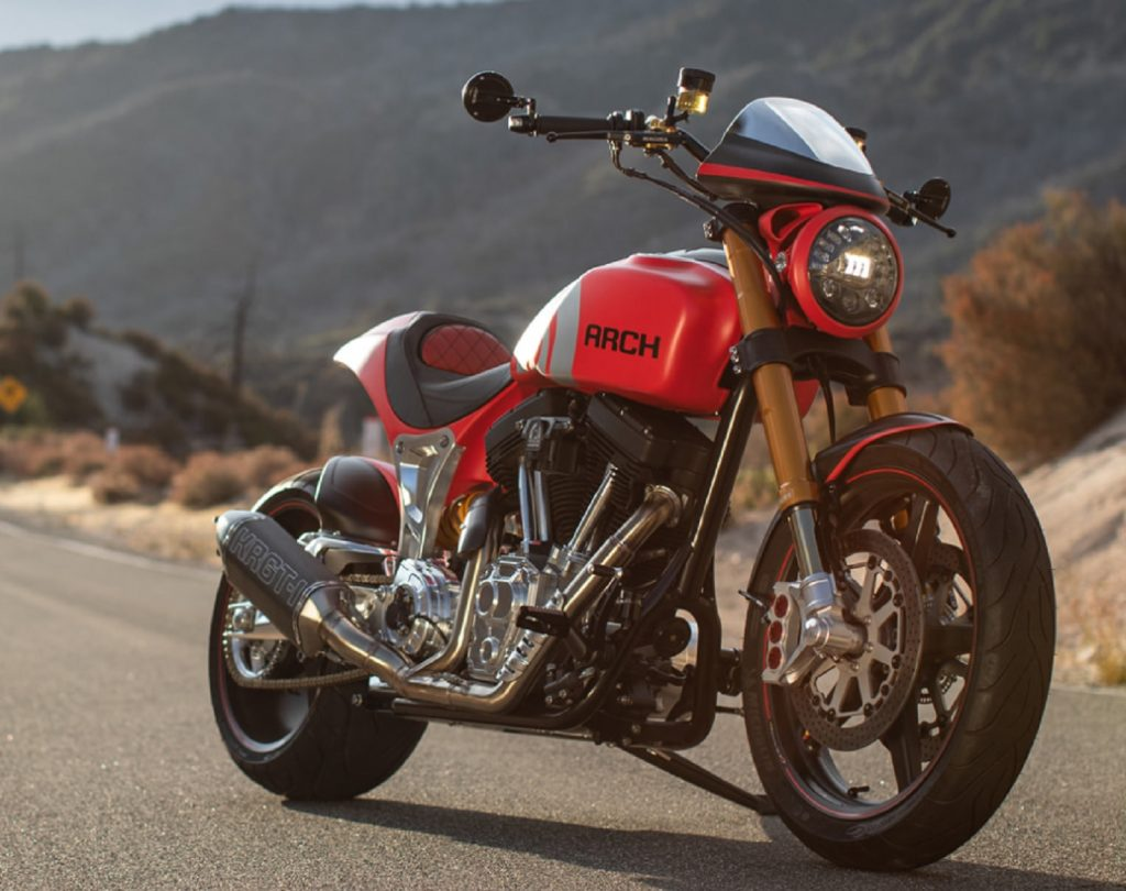 The front 3/4 view of a red 2020 Arch Motorcycle KRGT-1 on a canyon road