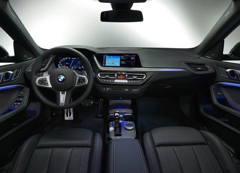The black interior of the 2020 BMW M235i xDrive Gran Coupe with blue ambient lighting