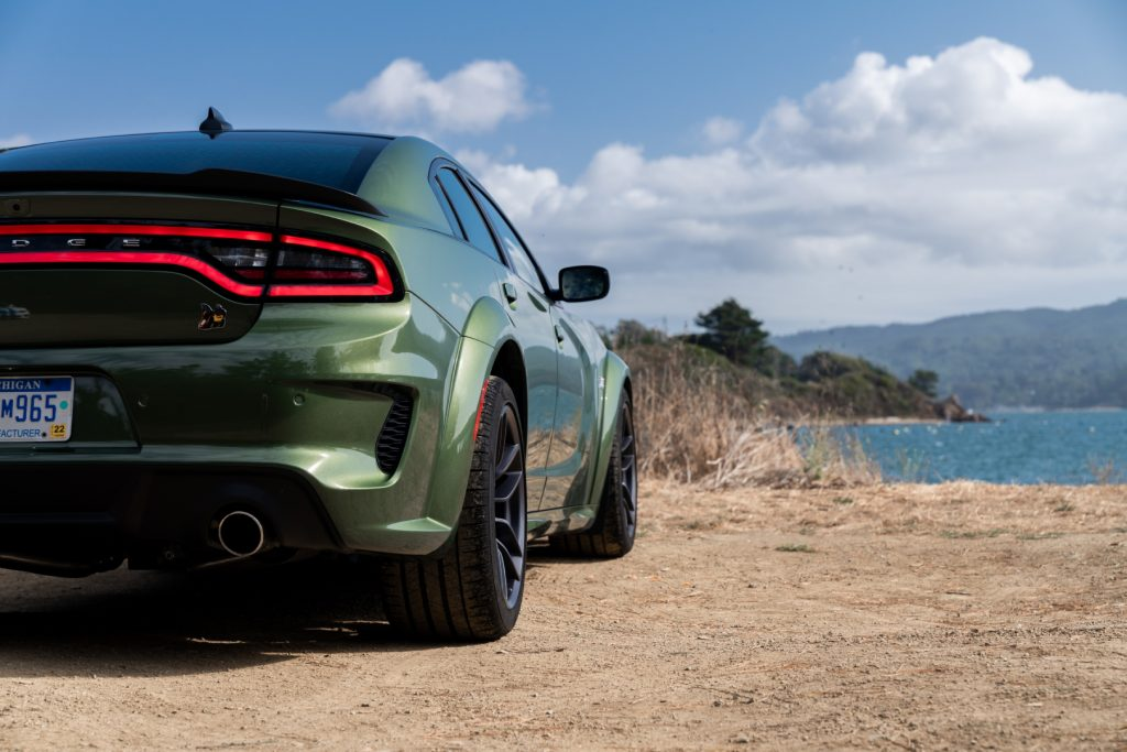 A Green 2020 Dodge Charger facing away toward the water