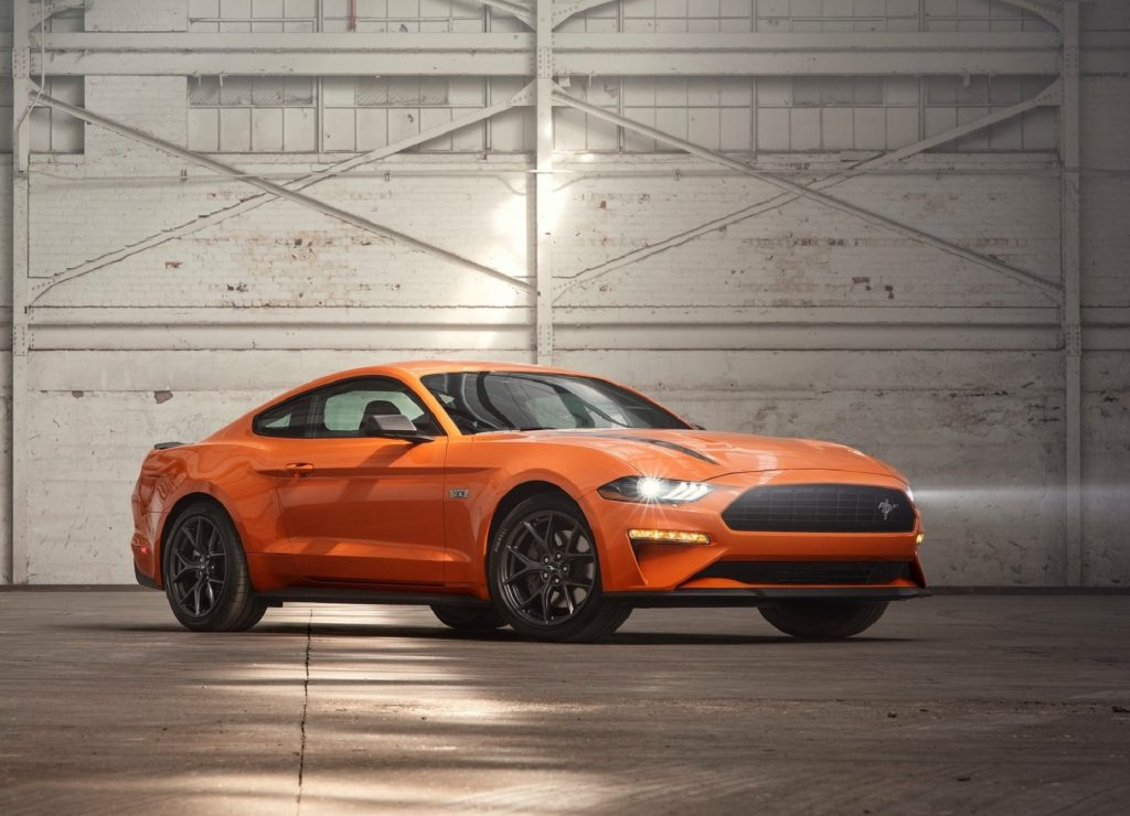 An orange 2020 Ford Mustang EcoBoost High Performance Package in a white-painted warehouse