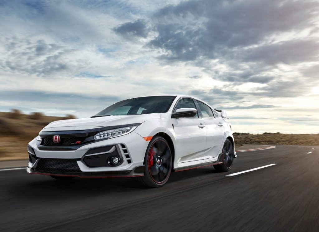 A white 2020 Honda Civic Type R drives down the road