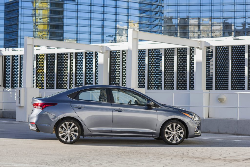 A silver 2020 Hyundai Accent parked in front of a building