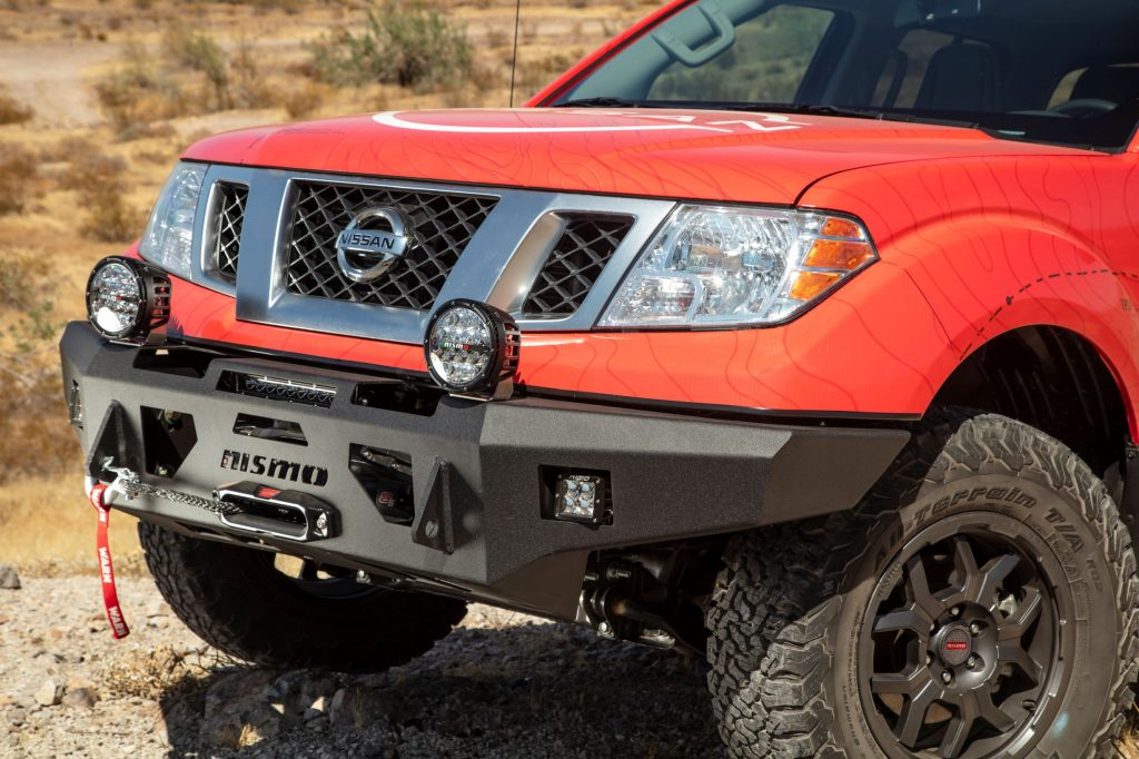 A red 2020 Nissan Frontier with a black powder-coated Nismo winch-ready bumper