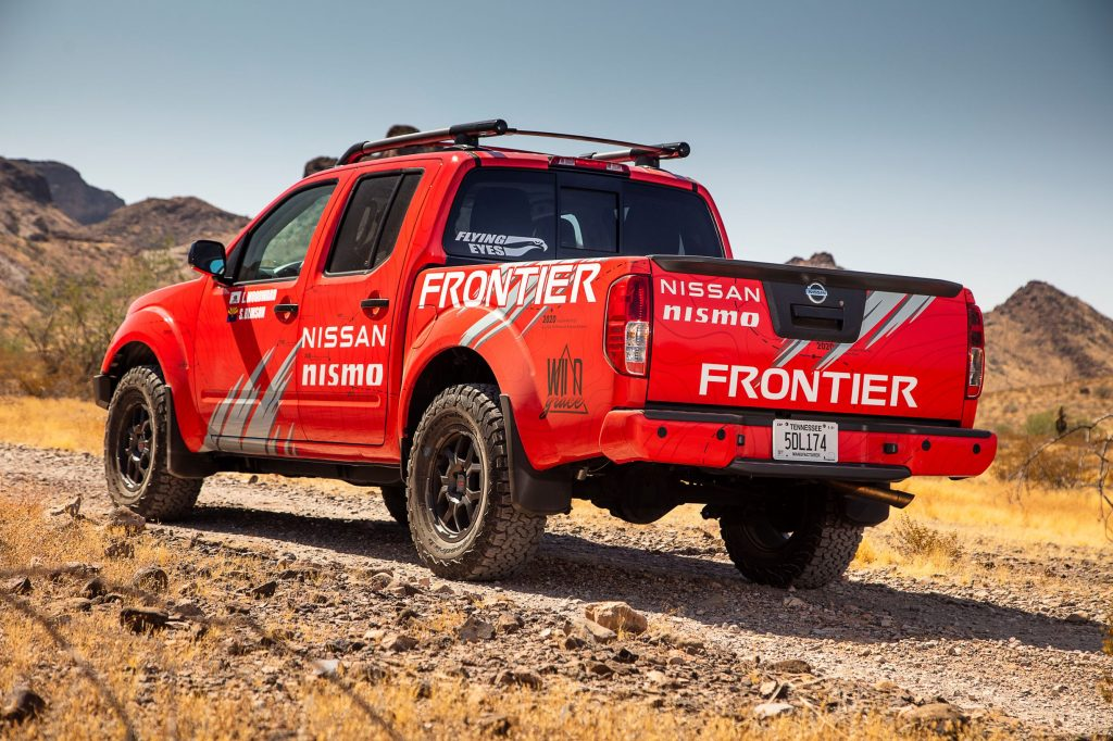 The rear view of a red 2020 Nissan Frontier modified by Nismo for the Rebelle Rally
