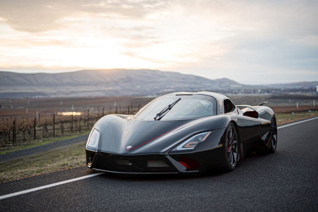A black 2020 SSC Tuatara on a road with mountains in the background