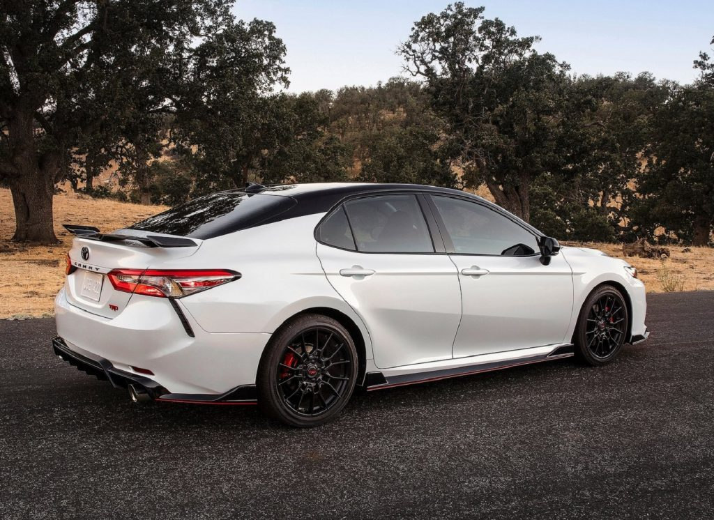 The rear 3/4 view of a white 2020 Toyota Camry TRD