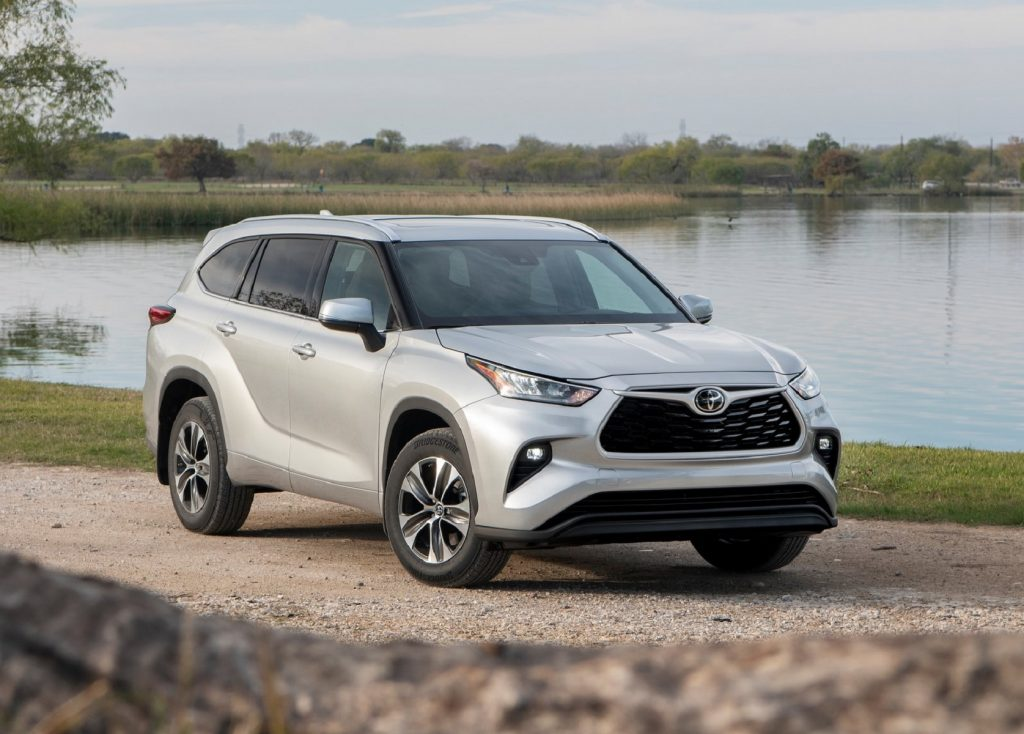 A silver 2020 Toyota Highlander by a lake